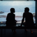 silhouette of man and woman talking
