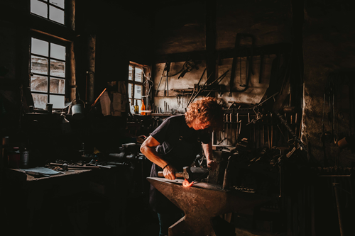 Man working with tools in a workshop