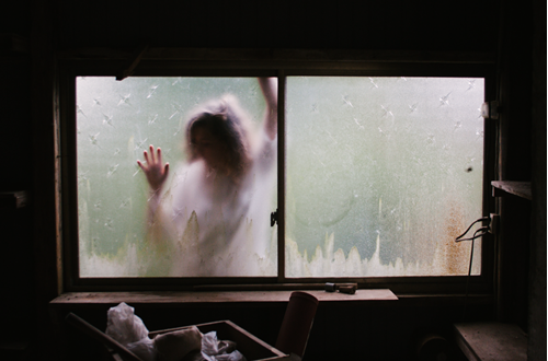 Woman on outside of window